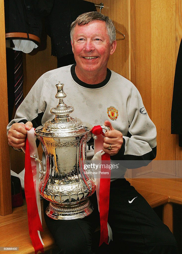 Sir Alex Ferguson of Manchester United celebrates with the FA Cup after winning the AXA FA Cup Final between Manchester United and Millwall at the Millennium Stadium on May 22, 2004 in Cardiff, Wales.