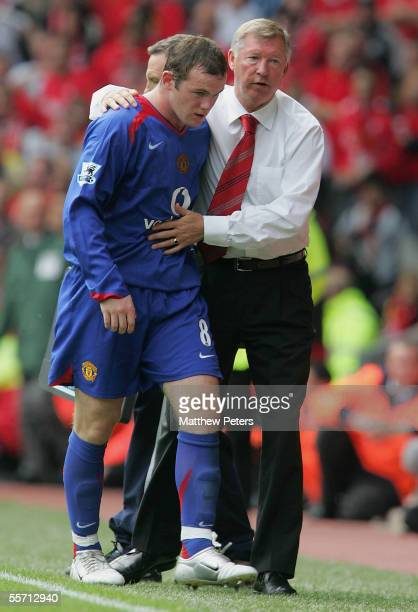 Sir Alex Ferguson of Manchester United consoles Wayne Rooney after substituting him during the Barclays Premiership match between Liverpool and...