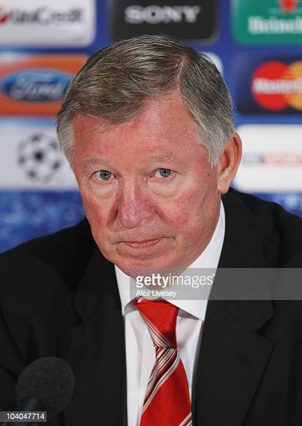 Sir Alex Ferguson of Manchester United faces the media during a press conference ahead of their UEFA Champions League matcg against Rangers held at...