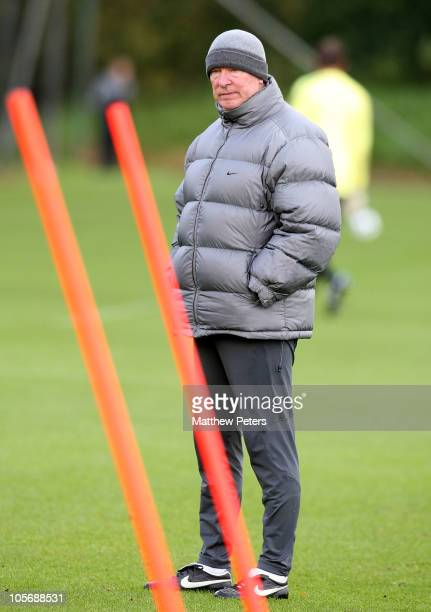 Sir Alex Ferguson of Manchester United in action during a first team training session, ahead of their UEFA Champions League match against Bursaspor,...
