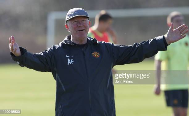 Sir Alex Ferguson of Manchester United in action during a first team training session ahead of their UEFA Champions League Round of 16 match against...