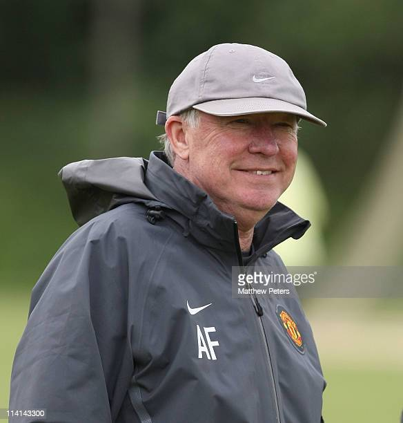 Sir Alex Ferguson of Manchester United in action during a first team training session at Carrington Training Ground on May 13, 2011 in Manchester,...