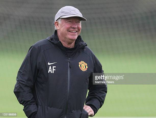 Sir Alex Ferguson of Manchester United in action during a first team training session at Carrington Training Ground on September 16, 2011 in...