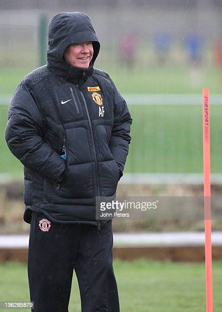 Sir Alex Ferguson of Manchester United in action during a first team training session at Carrington Training Ground on December 30, 2011 in...
