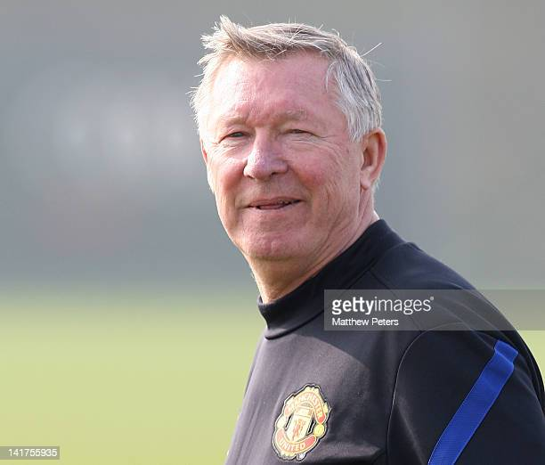 Sir Alex Ferguson of Manchester United in action during a first team training session at Carrington Training Ground on March 23, 2012 in Manchester,...