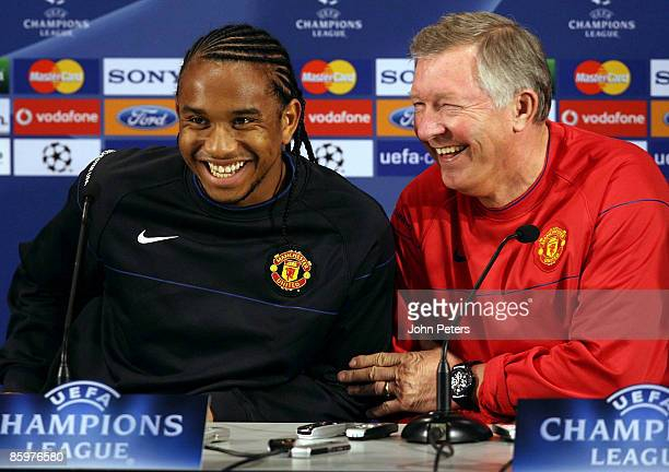 Sir Alex Ferguson of Manchester United laughs beside Anderson during a press conference ahead of their UEFA Champions League QuarterFinal Second...