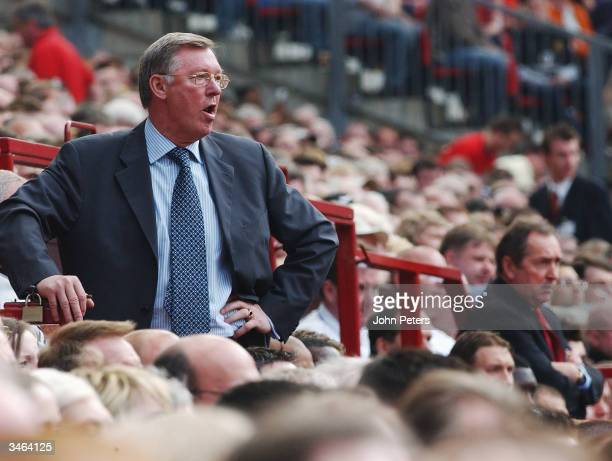 Sir Alex Ferguson of Manchester United looks annoyed in the dugout during the FA Barclaycard Premiership match between Manchester United and...