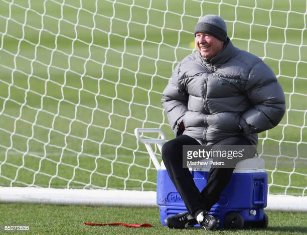 Sir Alex Ferguson of Manchester United looks on during a First Team training session at Carrington Training Ground on March 6 2009, in Manchester,...