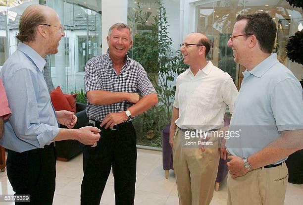 Sir Alex Ferguson of Manchester United meets Avram Glazer , Joel Glazer and Bryan Glazer , sons of new Manchester United owner Malcolm Glazer and new...