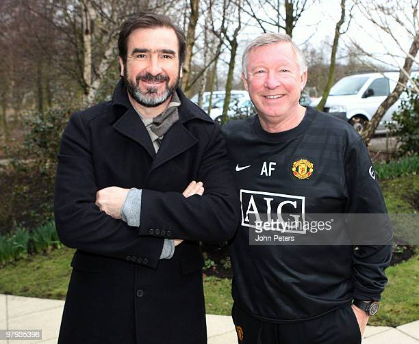 Sir Alex Ferguson of Manchester United meets former player Eric Cantona at Carrington Training Ground on March 22 2010 in Manchester England