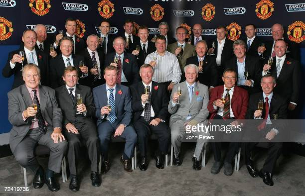 Sir Alex Ferguson of Manchester United poses with fellow football club managers past and present at the lunch to celebrate the 20th anniversary of...