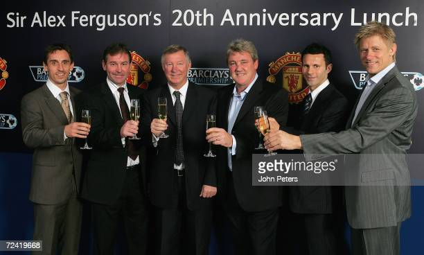 Sir Alex Ferguson of Manchester United poses with Gary Neville Bryan Robson Steve Bruce Ryan Giggs and Peter Schmeichel at the lunch to celebrate the...