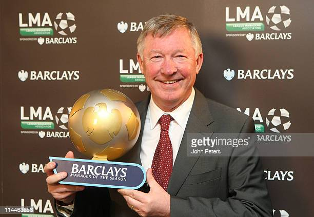 Sir Alex Ferguson of Manchester United poses with the Barclays Manager of the Season award at Carrington Training Ground on May 20, 2011 in...