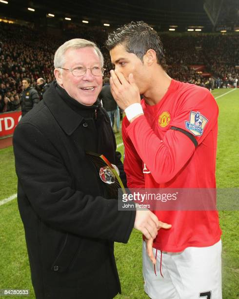 Sir Alex Ferguson of Manchester United presents Cristiano Ronaldo with his FIFA World Player of the Year award ahead of the Barclays Premier League...