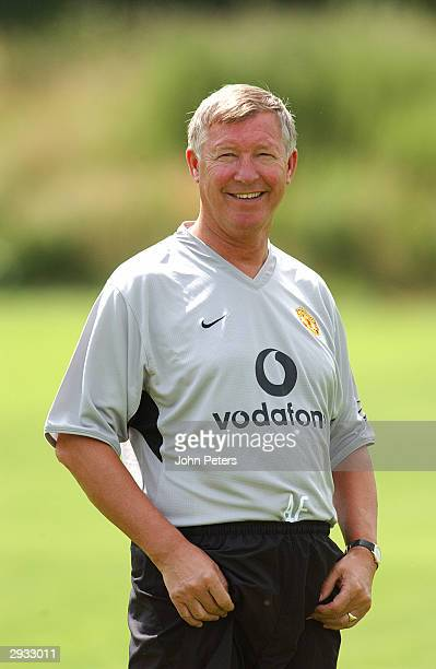 Sir Alex Ferguson of Manchester United returns to during pre season training at the Carrington Training Ground on July 8, 2003 in Manchester, England.