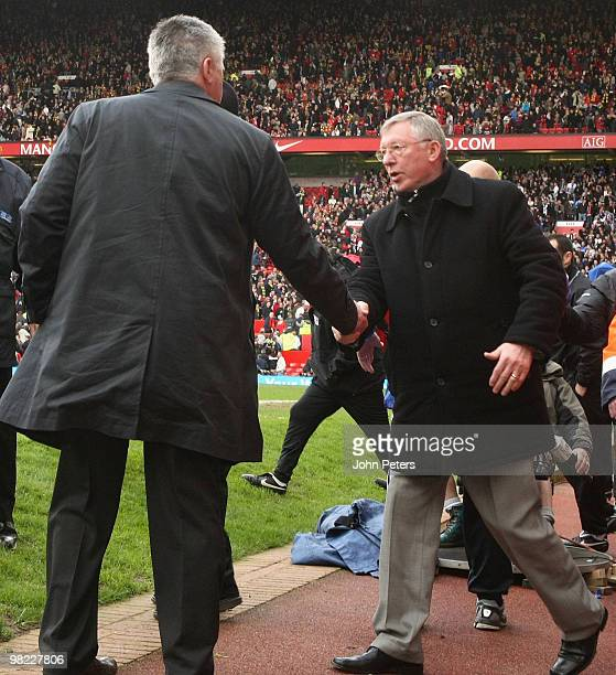 Sir Alex Ferguson of Manchester United shakes hands with Carlo Ancelotti of Chelsea after the FA Barclays Premier League match between Manchester...