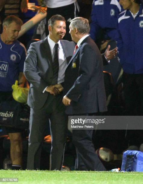 Sir Alex Ferguson of Manchester United shakes hands with his son Darren Ferguson of Peterborough United after the preseason friendly match between...