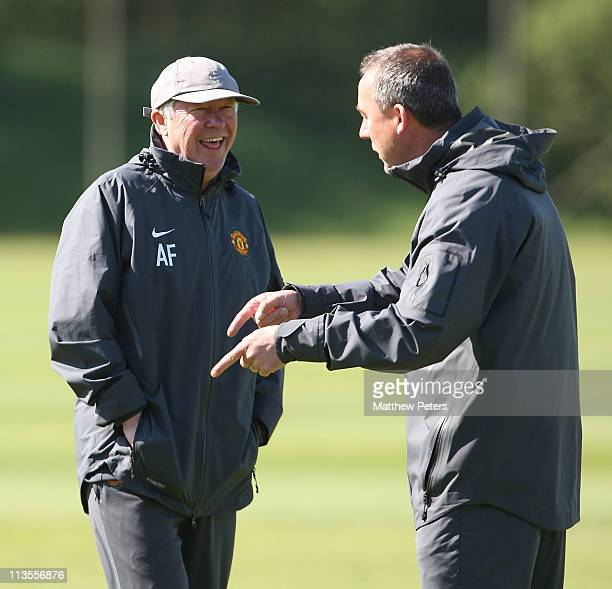 Sir Alex Ferguson of Manchester United shares a joke with coach Rene Meulensteen ahead of their UEFA Champions League Semi-Final second leg against...