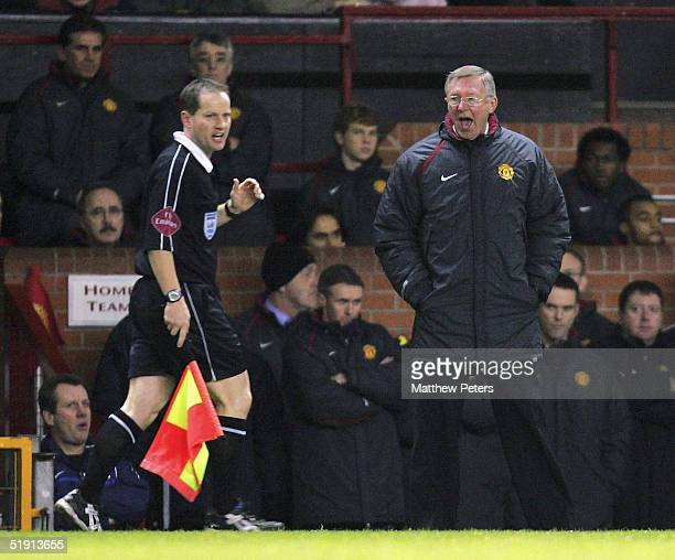 Sir Alex Ferguson of Manchester United shouts at assistant referee Rob Lewis during the Barclays Premiership match between Manchester United and...
