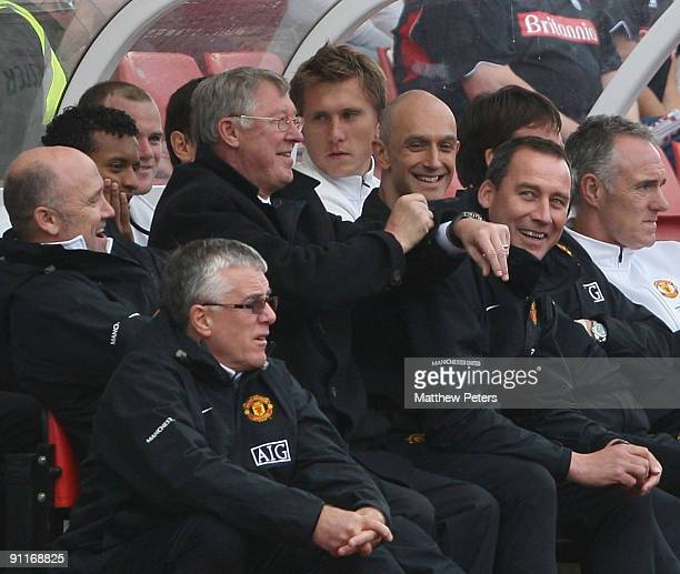 """Sir Alex Ferguson of Manchester United shows his watch to the crowd after chants of """"Fergie Fergie what's the time?"""" during the Barclays FA Premier..."""