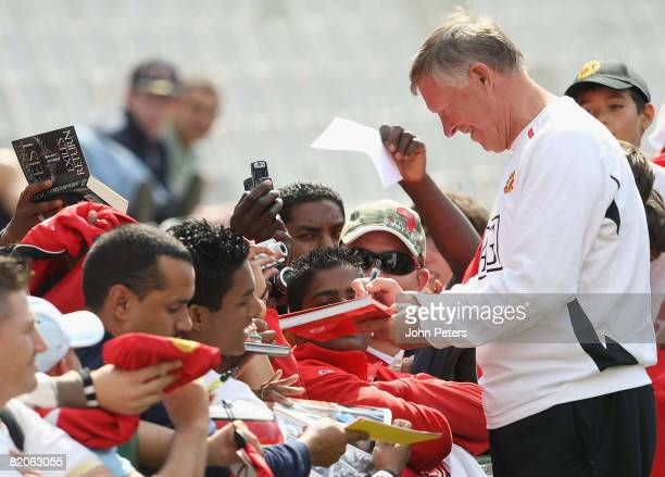 Sir Alex Ferguson of Manchester United signs autographs during a first team training session during their preseason tour to South Africa at Loftus...