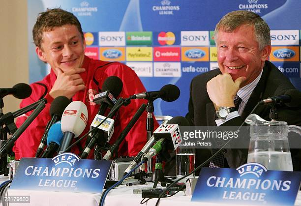 Sir Alex Ferguson of Manchester United smiles during a press conference ahead of the UEFA Champions League match against FC Copenhagen at Old...