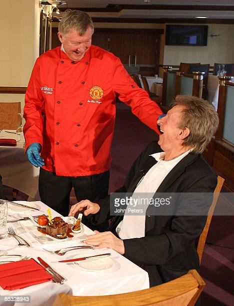 Sir Alex Ferguson of Manchester United takes part in the MUTV cookery programme Red Devils Kitchen cooking for United legend Denis Law at Old...