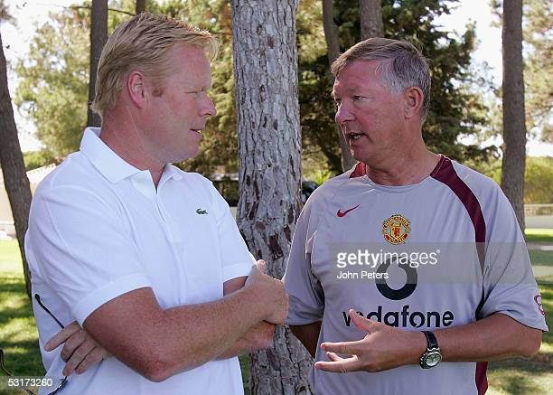 Sir Alex Ferguson of Manchester United talks to Benfica manager Ronald Koeman during a preseason first team training session on June 30 2005 in Vale...