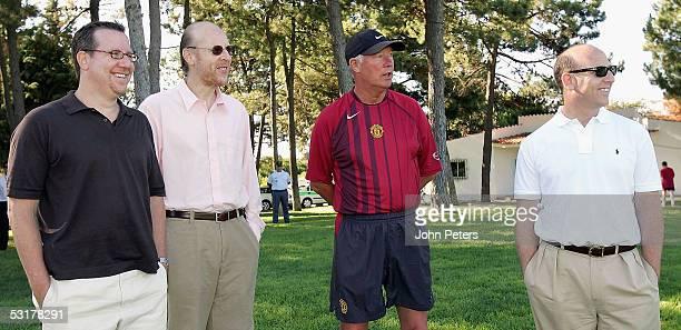 Sir Alex Ferguson of Manchester United talks to Bryan Glazer , Avram Glazer and Joel Glazer during a pre-season first team training session on 1 July...