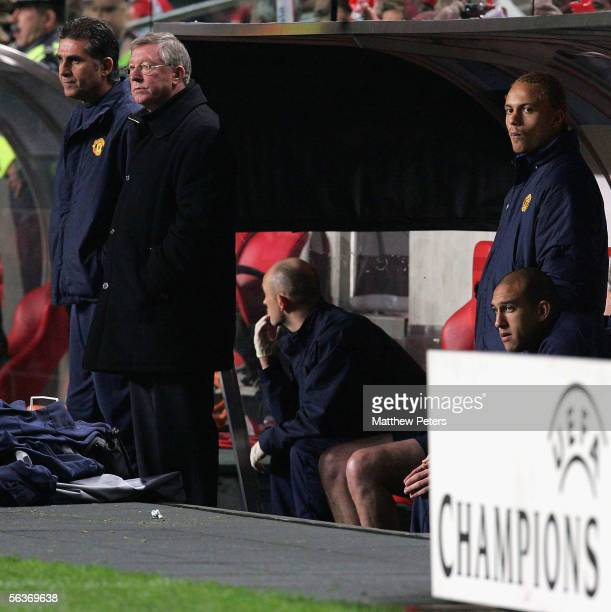 Sir Alex Ferguson of Manchester United watches from the bench during the UEFA Champions League match between Benfica and Manchester United at the...