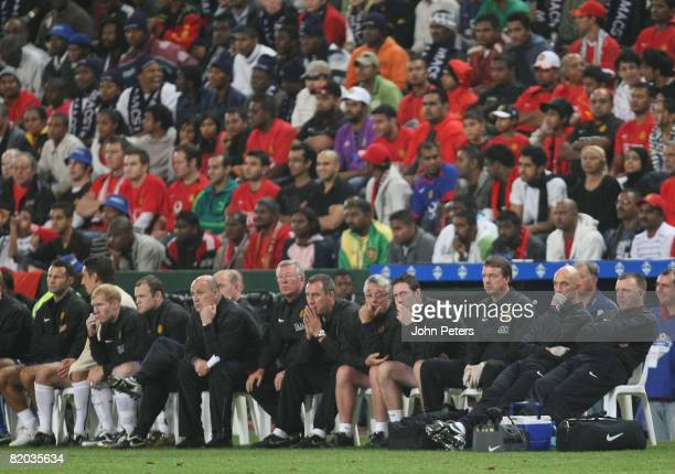 Sir Alex Ferguson of Manchester United watches from the bench with his coaching staff and substitutes during the Vodacom Challenge preseason friendly...