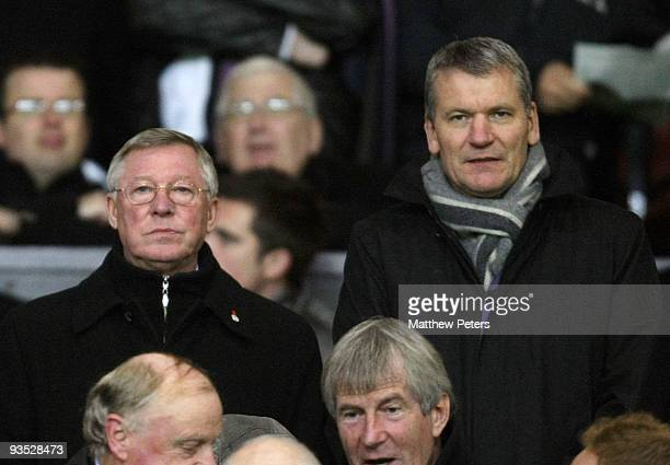 Sir Alex Ferguson of Manchester United watches from the directors' box during the Carling Cup Quarter Final match between Manchester United and...