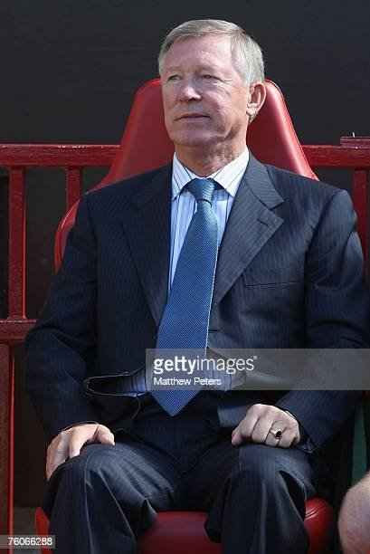 Sir Alex Ferguson of Manchester United watches from the dugout during the Barclays FA Premier League match between Manchester United and Reading at...