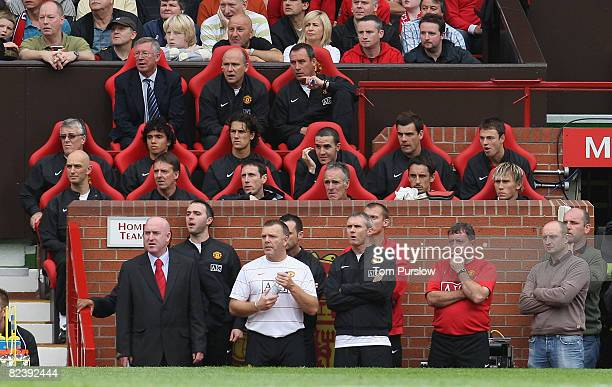 Sir Alex Ferguson of Manchester United watches from the dugout during the FA Premier League match between Manchester United and Newcastle United at...