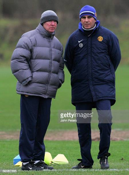 Sir Alex Ferguson of Manchester United watches from the sidelines during a first team training session at Carrington Training Ground on January 13...