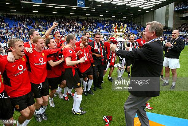 Sir Alex Ferguson passes the Barclaycard Premiership trophy to his captain Roy Keane after the FA Barclaycard Premiership match between Everton v...
