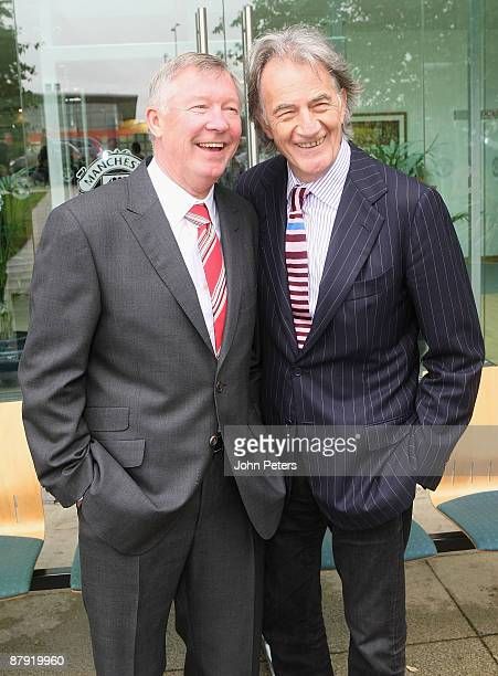 Sir Alex Ferguson poses with Sir Paul Smith as the Manchester United squad pose in suits designed by Paul Smith ahead of the UEFA Champions League...