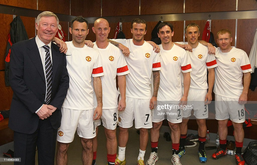 Sir Alex Ferguson, Ryan Giggs, Nicky Butt, David Beckham, Gary Neville, Phil Neville and Paul Scholes of Manchester United recreate the famous Class of '92 photo from 1992 ahead of Gary Neville's testimonial match between Manchester United and Juventus at Old Trafford on May 24, 2011 in Manchester, England.