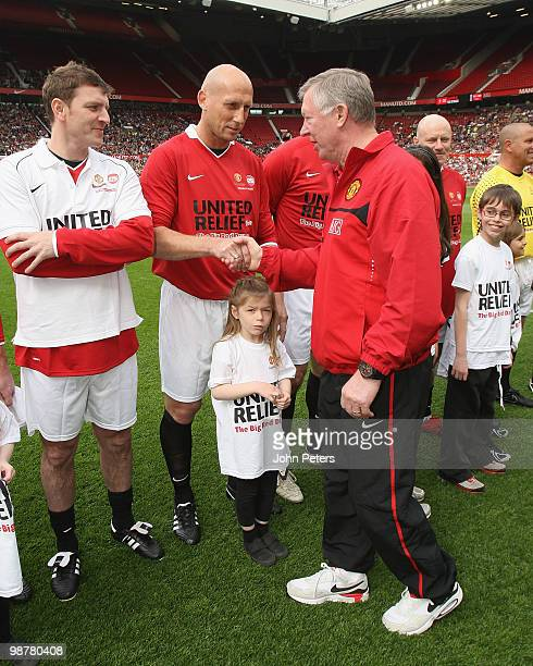 Sir Alex Ferguson shakes hands with Jaap Stam ahead of the United Relief charity match in aid of Sport Relief and the Manchester United Foundation...