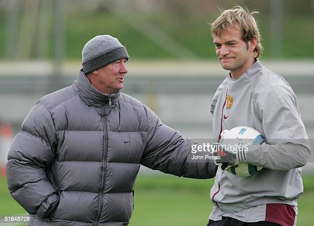 Sir Alex Ferguson smiles with Roy Carroll of Manchester United during a first team training session ahead of the UEFA Champions League match against...
