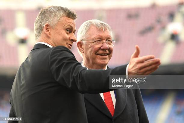 Sir Alex Ferguson speaks to Ole Gunnar Solskjaer, Manager of Manchester United on the pitch prior to the UEFA Champions League Quarter Final second...