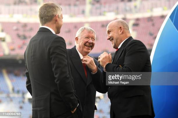 Sir Alex Ferguson speaks to Ole Gunnar Solskjaer, Manager of Manchester United and Mike Phelan on the pitch prior to the UEFA Champions League...