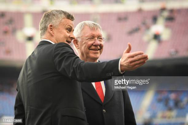 Sir Alex Ferguson speaks to Ole Gunnar Solskjaer Manager of Manchester United on the pitch prior to the UEFA Champions League Quarter Final second...