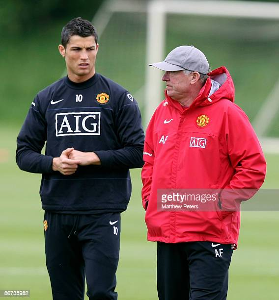 Sir Alex Ferguson speaks with Cristiano Ronaldo of Manchester United during a First Team training session at Carrington Training Ground on May 8 2009...