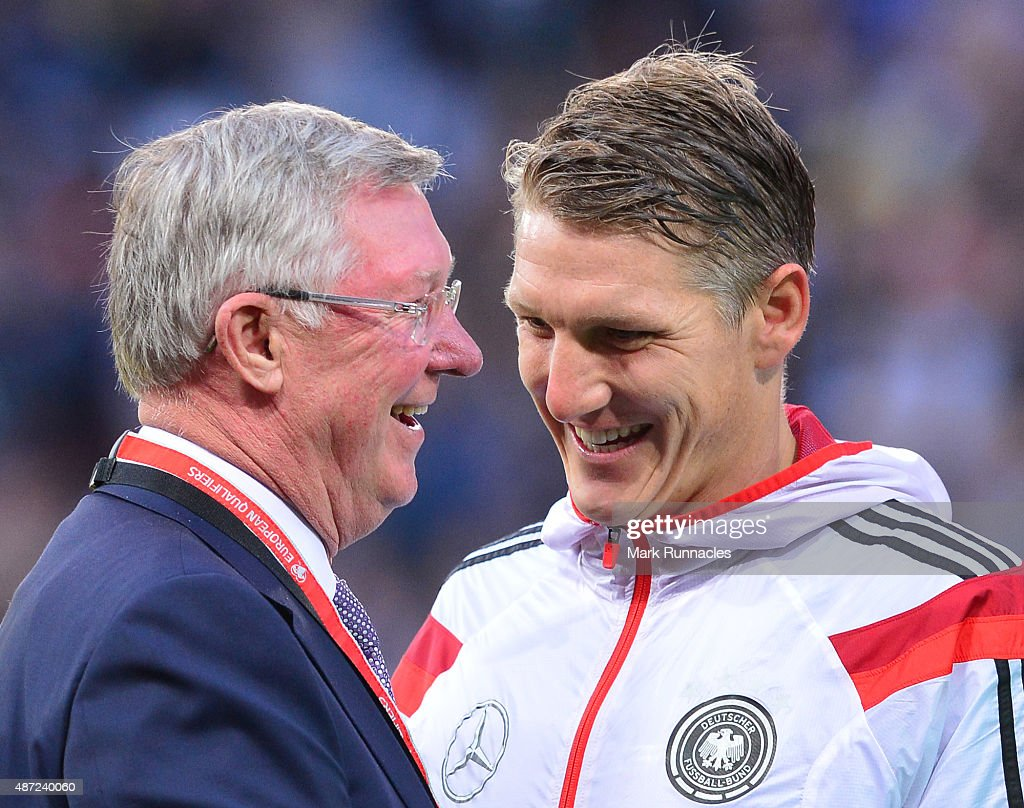 Sir Alex Ferguson talking with Bastian Schweinsteiger before the EURO 2016 Qualifier between Scotland and Germany at Hamden Park on September 7, 2015 in Glasgow, Scotland.
