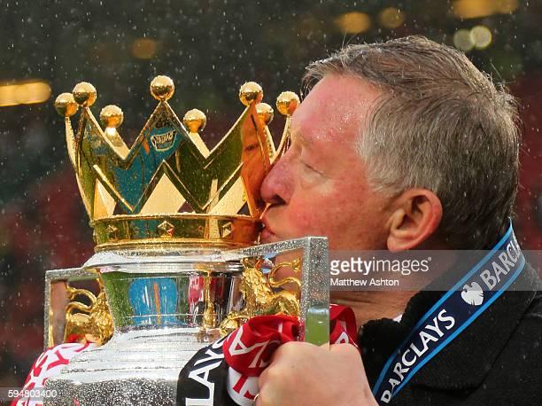 Sir Alex Ferguson the head coach / manager of Manchester United kisses the Barclays Premier League trophy