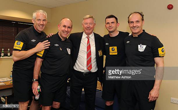 Sir Alex Ferguson the head coach / manager of Manchester United poses for photographs with the match officials after his 1500th and final match at...