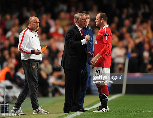 Sir Alex Ferguson the head coach / manager of Manchester United talks to Wayne Rooney of Manchester United