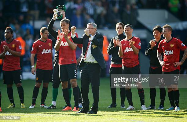 Sir Alex Ferguson the head coach / manager of Manchester United applauds the fans after his last game