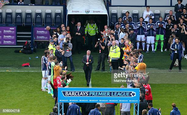 Sir Alex Ferguson the head coach / manager of Manchester United walks out through a guard of honour before the game